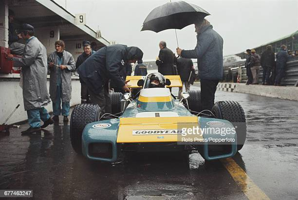 British Formula 1 racing driver Graham Hill pictured seated in the Brabham BT34 'lobster claw' racing car prior to the start of the 1971 Race of...