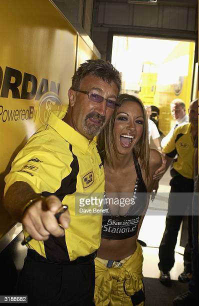 British Formula One boss Eddie Jordan and British model Jodie Marsh attend a photoshoot for Playstation's new game Formula One 2003 at the British...
