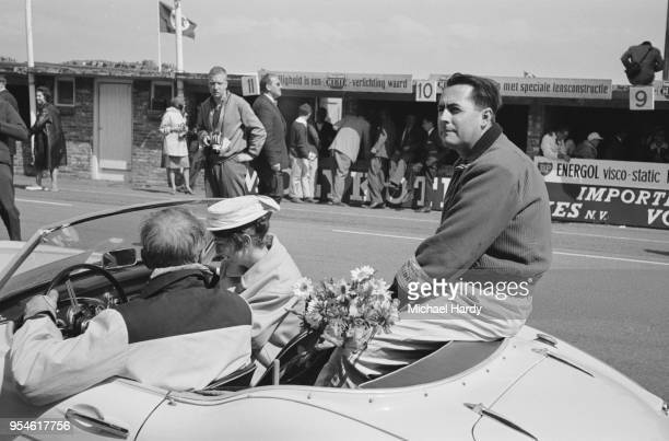 British Formula One driver Jack Brabham sitting in the back of a car after the Dutch Grand Prix, in which he placed sixth, Circuit Park Zandvoort,...