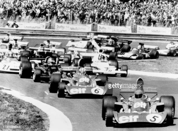 British Formula One driver Jackie Stewart leads the German Formula One Grand Prix ahead of his teammate François Cevert and Swedish Formula One...