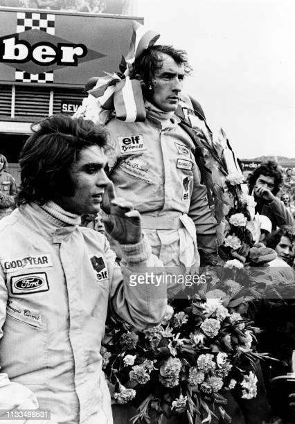British Formula One driver Jackie Stewart shares the podium with French François Cevert after the 1973 Dutch Grand Prix in Zandvoort on July 29 1973