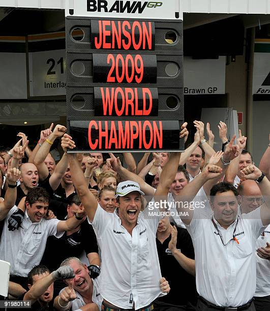 British Formula One driver Jenson Button celebrates with his team's members his F1 World Champion title after the Brazil's Formula 1 GP on October 18...