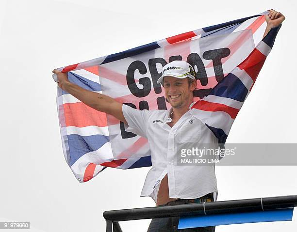 British Formula One driver Jenson Button celebrates with the Union Jack his 2009 F1 World title after finishing fifth in Brazil's Formula 1 GP...