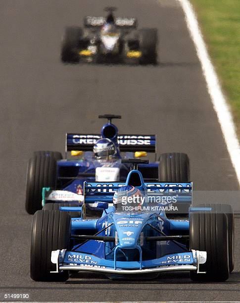 British Formula One driver Jenson Button drives his BenettonRenault down the main straight ahead of Kimi Raikkonen of Finland and Fernando Alonso of...