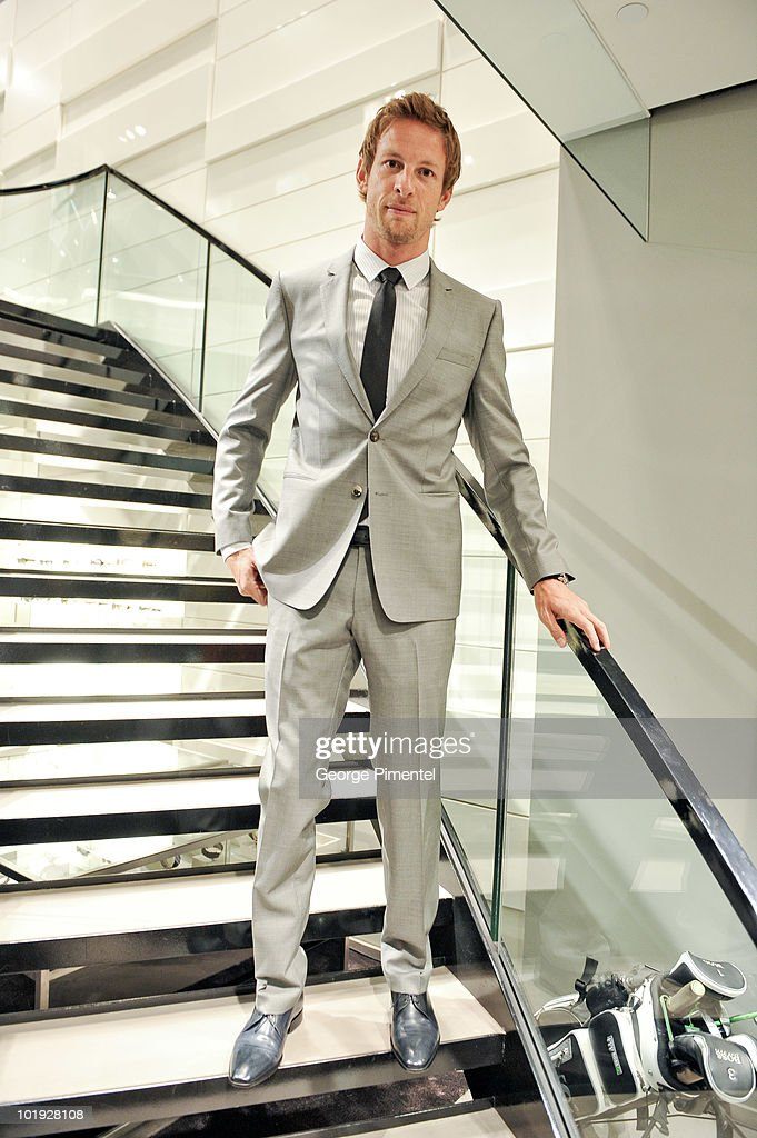 British Formula One driver Jenson Button Visits Hugo Boss