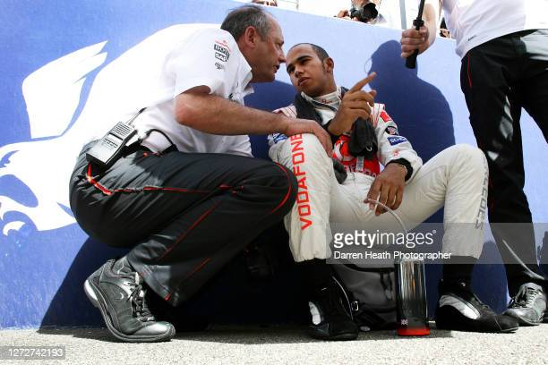 British Formula One driver Lewis Hamilton chats with McLaren Team Principal Ron Dennis on the pre race grid prior to the 2007 Bahrain Grand Prix held...