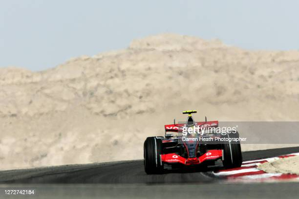 British Formula One driver Lewis Hamilton drives his McLaren MP4-22 V8 Formula One car during practice for the 2007 Bahrain Grand Prix held at the...