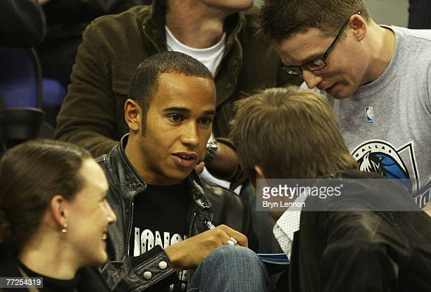 British Formula One driver, Lewis Hamilton signs autographs for fans during NBA Europe Live 2007 Tour match between the Boston Celtics and the...