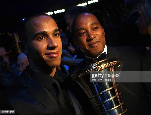 British Formula One driver Lewis Hamilton with FIA Formula One World Championship trophy 2008 pose with father Anthony Hamilton during the 2008 FIA...