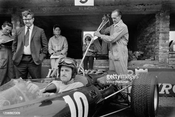 British Formula One racing driver Graham Hill at the wheel of his car during practice ahead of the 1965 Grand Prix of the Netherlands, at Circuit...