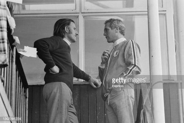 British Formula One racing driver Graham Hill chatting to American actor Paul Newman at the Universal Motor Racing Club school at Brands Hatch motor...