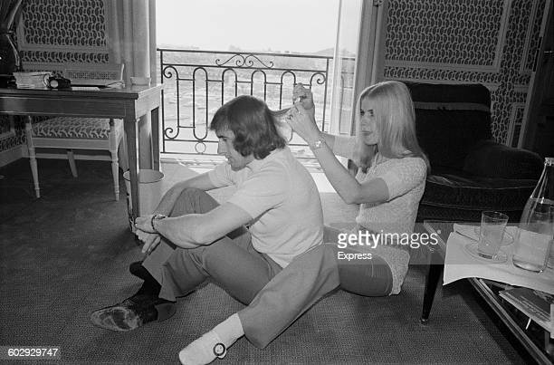 British Formula One racing driver Jackie Stewart gets his hair cut by his wife Helen in Monte Carlo Monaco 8th May 1970 He is in the city to take...