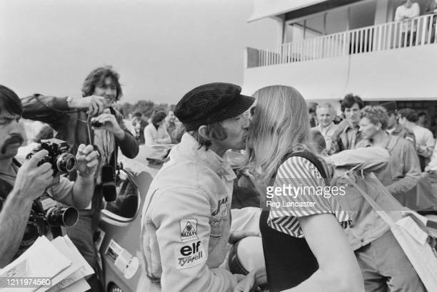 British Formula One racing driver Jackie Stewart kisses his wife Helen as photographers capture the moment at the Circuit Paul Ricard where Stewart...