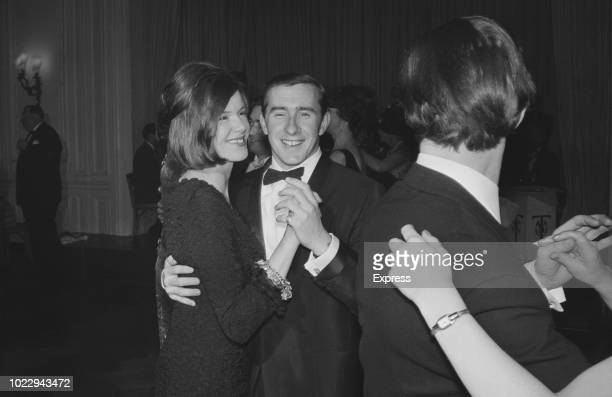 British Formula One racing driver Jackie Stewart with his wife Helen dancing together at the Doghouse Owners' Ball London UK 24th November 1965