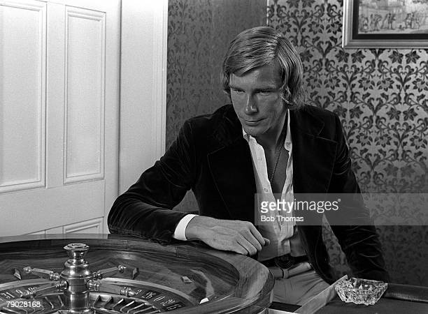 British Formula One racing driver James Hunt pictured beside a roulette wheel at the Rubicon Sporting Club in Northampton, England in 1975.