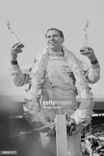 British Formula One racing driver Jim Clark celebrates his victory at the British Grand Prix Silverstone UK 20th July 1963