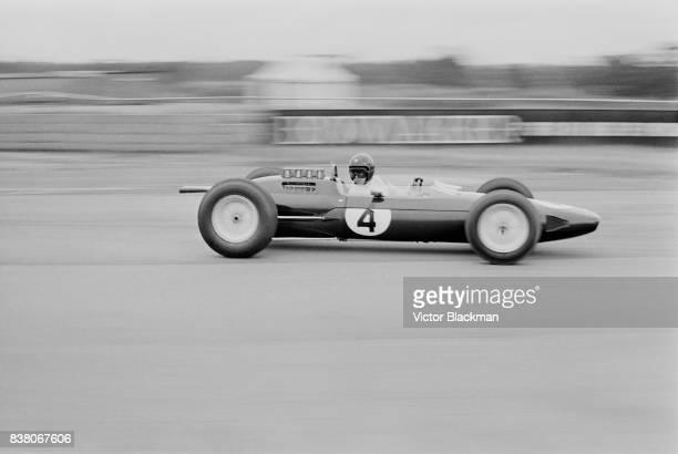 British Formula One racing driver Jim Clark drives the Team Lotus Lotus 25 Climax V8 during the British Grand Prix at Silverstone UK 20th July 1963
