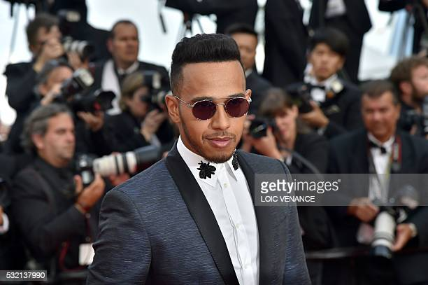 British Formula One racing driver Lewis Hamilton arrives on May 18 2016 for the screening of the film 'The Unknown Girl ' at the 69th Cannes Film...