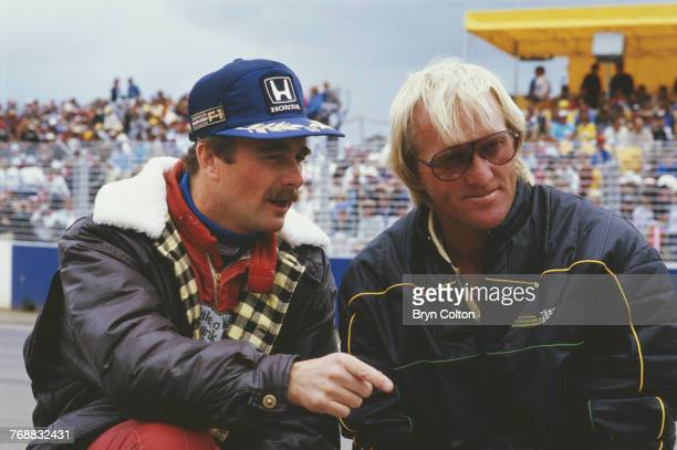 British Formula One racing driver Nigel Mansell of the WilliamsHonda team with Australian golfer Greg Norman in the pit lane before the start of the...