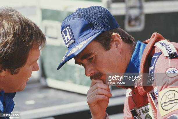 British Formula One racing driver Nigel Mansell of the WilliamsHonda team speaks with Patrick Head head of engineering at Williams before the start...