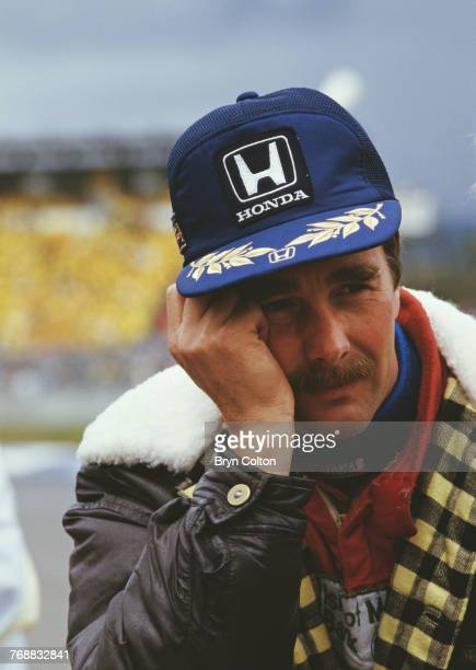 British Formula One racing driver Nigel Mansell, of the Williams-Honda team, in the pit lane before the start of the 1986 Australian Grand Prix at...