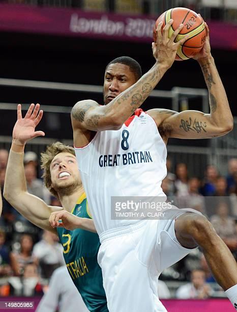 British forward Drew Sullivan vies with Australian guard Matt Dellavedova during the men's preliminary round group B basketball match Great Britain...