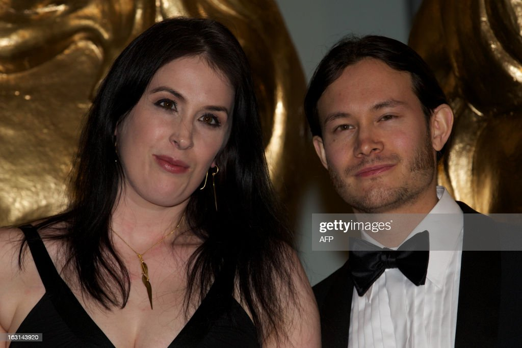 British freelance computer game script writer Rhianna Pratchett (L) poses on the red carpet arriving for the BAFTA British Academy Games Awards in central London on March 5, 2013.