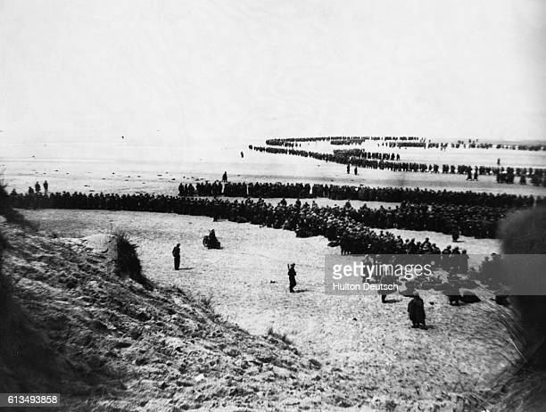 British & French troops waiting on the dunes at Dunkirk to be picked up by the destroyers to bring them back to England during the Dunkirk...