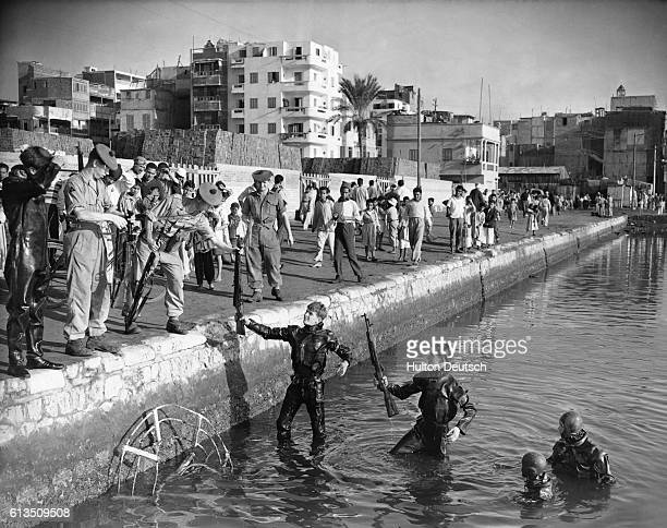 British frogmen recover weapons hidden by Egyptian forces in the Suez Canal. During the Suez Crisis of 1956, British troops scoured much of the area...