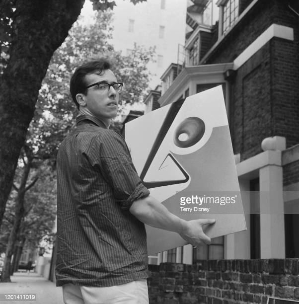 British gallerist Nicholas Treadwell loading a painting into his mobile art gallery, 19th July 1965.