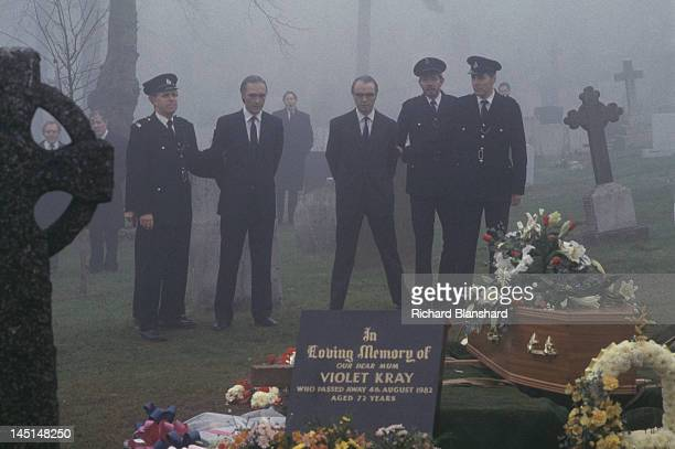 British gangsters Reggie and Ronnie Kray under guard at their mother's funeral in a scene from 'The Krays' directed by Peter Medak 1990