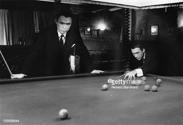 British gangsters Reggie Kray played by Martin Kemp and Ronnie Kray played by Gary Kemp playing snooker at their billiard hall headquarters in the...