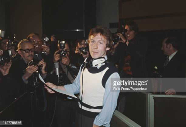 British gardener and singer, Roddy Llewellyn pictured at a press photo call wearing headphones in a recording studio prior to recording his first...