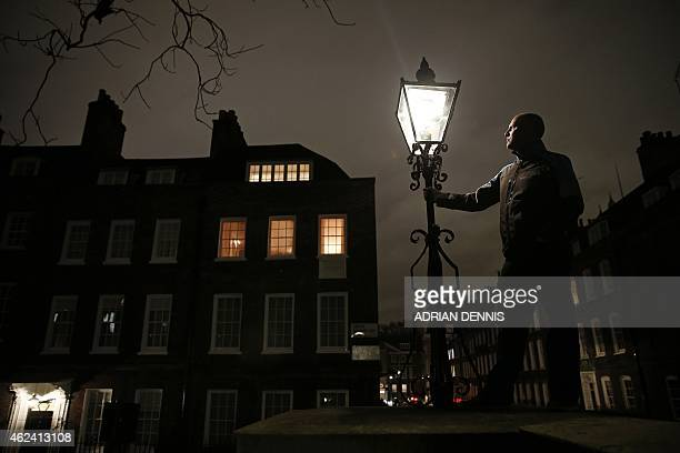 British Gas Operations Manager Iain Bell inspects a gas burning street light in central London on January 14 2015 Despite nationwide budget cuts that...