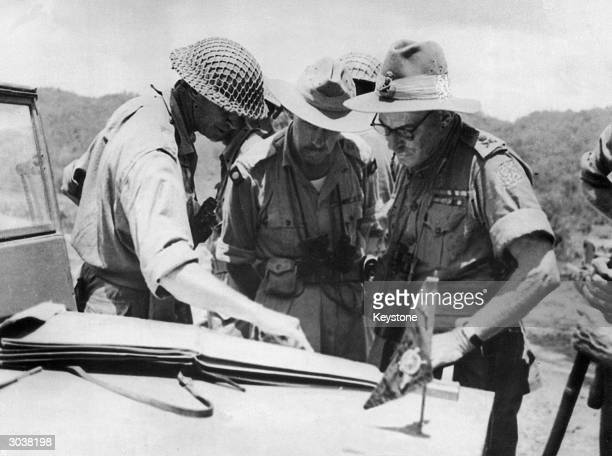 A British General and a Brigadier from an Indian division meet to discuss the recent Allied victory on the ImphalKohima road in Burma during World...