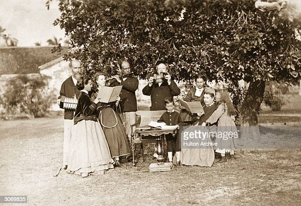 British General Augustus Ritherdon playing concertinas with his family in Madras