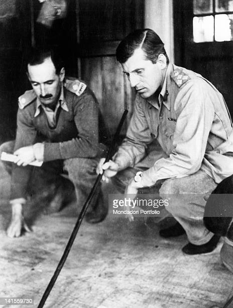 British general Orde Charles Wingate and another officer studying a topographic map in view of carrying forward the Chindit operation Burma February...