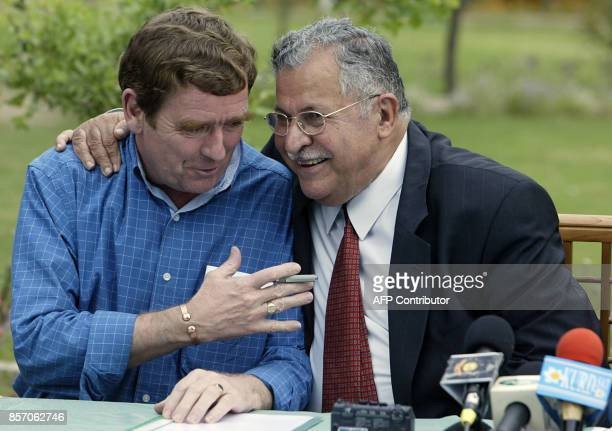 British General Tim Cross deputy to retired US Lt General Jay Garner confers with Jalal Talabani leader of the Patriotic Union of Kurdistan during a...