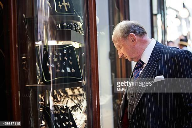 British gentleman looking at jewelry in the Burlington Arcade