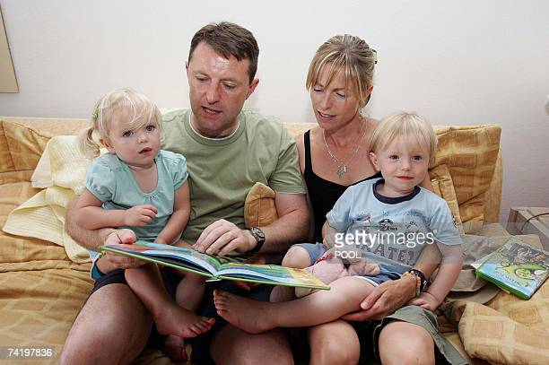 British Gerry and Kate McCann are seen with their children Sean and Amelie in their appartment in Praia da Luz in Portugal 19 May 2007 Madeleine...