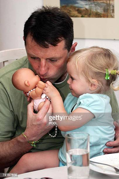 British Gerry McCann plays with his daughter Amelie in their appartment in Praia da Luz in Portugal 19 May 2007 Madeleine McCann vanished from a...
