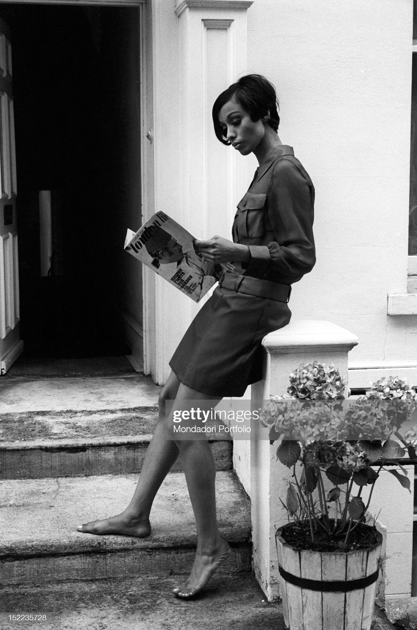 https://media.gettyimages.com/photos/british-girl-barefoot-and-in-miniskirt-reading-a-number-of-the-life-picture-id152235728?s=2048x2048