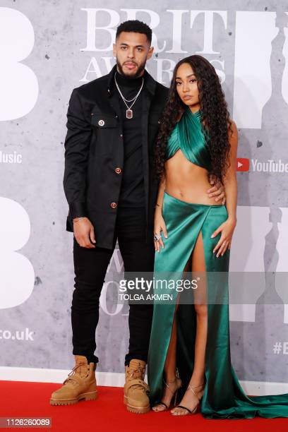 British girl group 'Little Mix' member LeighAnne Pinnock and footballer Andre Gray pose on the red carpet on arrival for the BRIT Awards 2019 in...