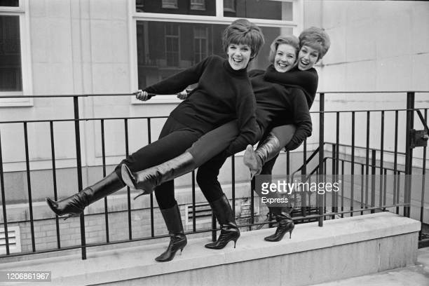British girl group The Breakaways , kicking out in unison, while holding a railing for support, 20th November 1963.