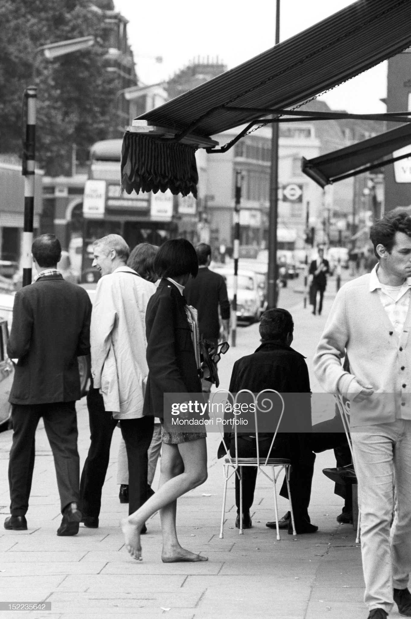 https://media.gettyimages.com/photos/british-girl-wearing-a-miniskirt-walking-barefoot-in-the-streets-of-picture-id152235642?s=2048x2048