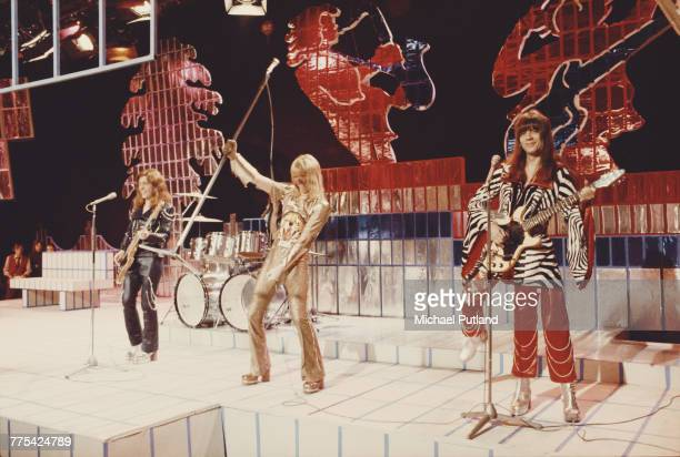 British glam rock group Sweet perform on stage on the Christmas Day edition of the BBC TV music show 'Top Of The Pops' broadcast 25th December 1973...