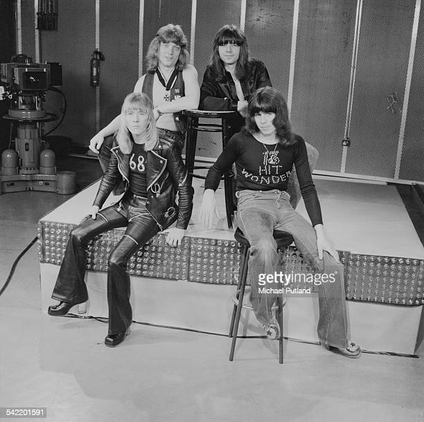 British glam rock group The Sweet at a TV studio June 1975 Clockwise from bottom left singer Brian Connolly bassist Steve Priest guitarist Andy Scott...