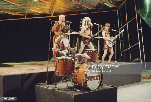British glam rock group The Sweet perform on stage on the BBC TV music show 'Top Of The Pops' in London circa 1972 The group are from left to right...