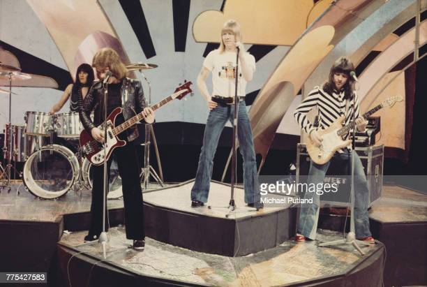 British glam rock group The Sweet perform on stage on the BBC TV music show 'Top Of The Pops' in London in 1974 The group are from left to right...