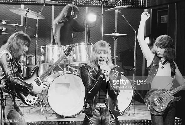 British glam rock group The Sweet performing at a TV studio June 1975 Left to right guitarist Andy Scott drummer Mick Tucker singer Brian Connolly...